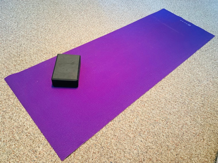 purple yoga mat and block