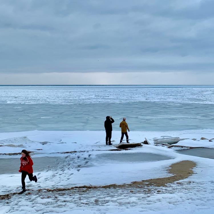 kids by a frozen lake