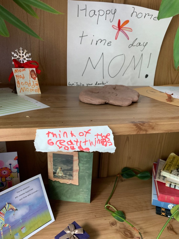 bookshelf with cards and kids' notes