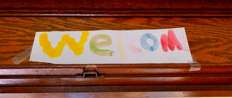 kids' painted welcome sign