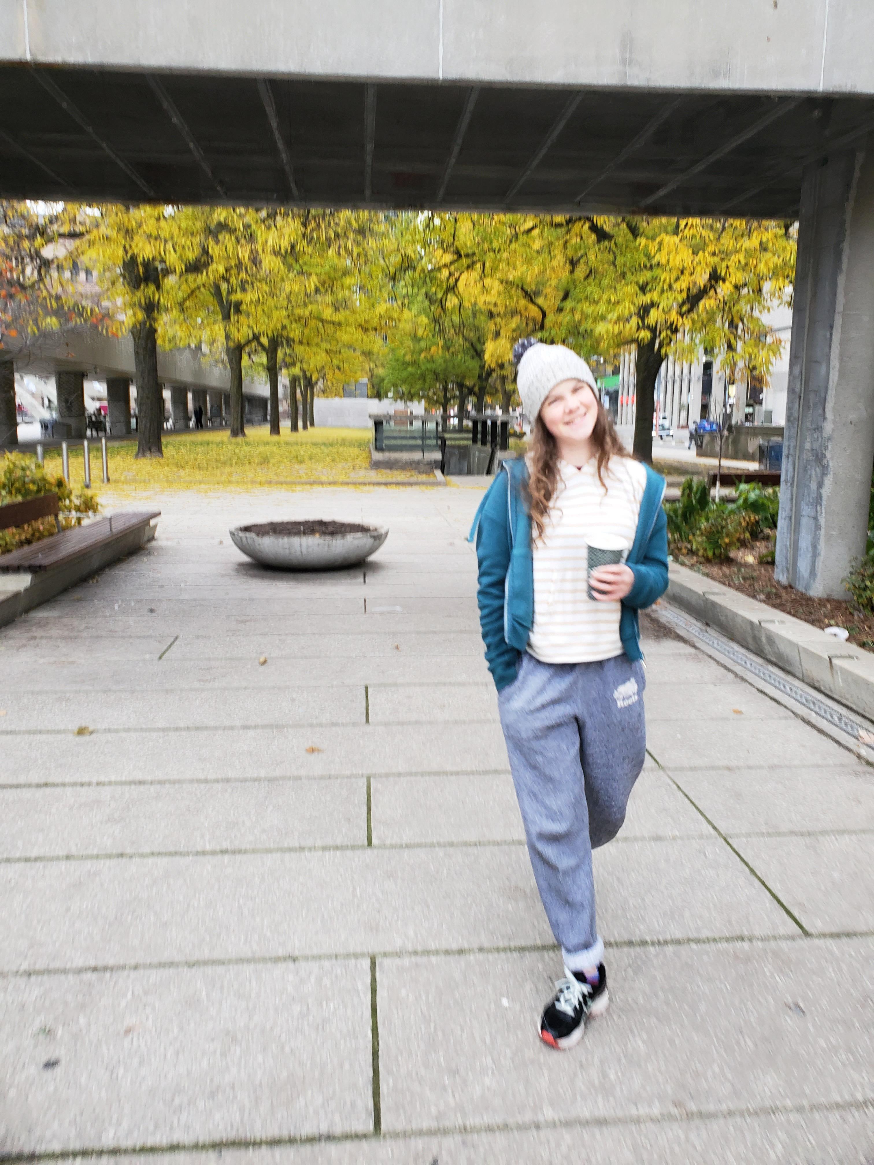 beautiful teenage girl walking with fall trees