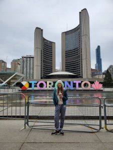 beautiful teenage girl in front of Toronto City Hall
