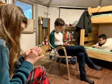 3 teenagers on phones